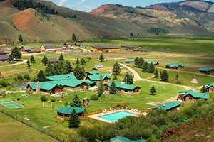 The Red Rock Ranch - Book Now For Summer 2018 :: True Western Dude Ranch! Private log cabins, exceptional cuisine, horseback riding, kids programs, & private fly fishing make for a unique Jackson Hole dude ranch experience!