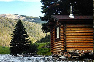 Flat Creek Ranch - Luxury Wilderness Retreat :: Stay at our historic wilderness retreat & enjoy elegant cabins, gourmet cuisine, legendary trout fishing, hiking & horseback riding. Open June-Sept, 3 night minimum.
