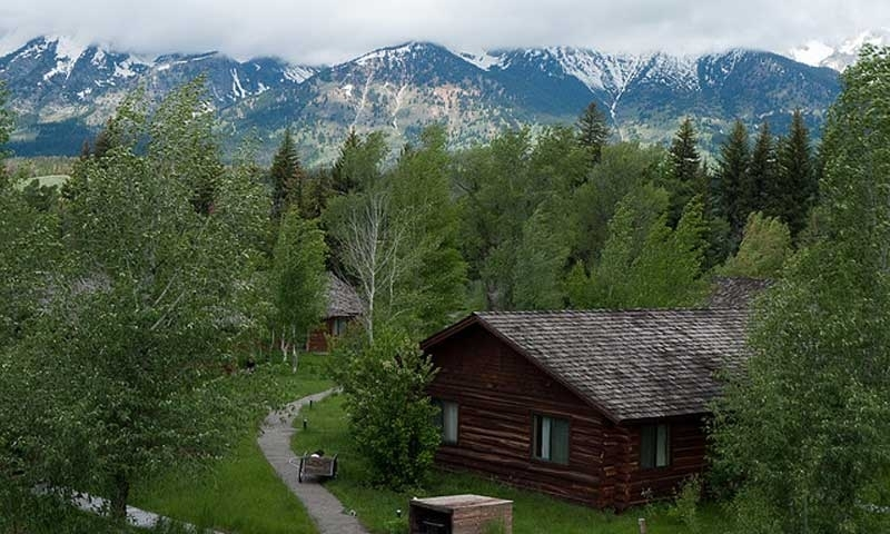 shane in stock image photo park of grand cabins clouds teton the national